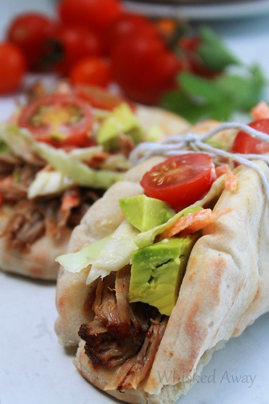 These crock pot Shredded Rubbed Pork Gyros with Homemade Slaw made my house smell so good while it cooked, and it tasted just as amazing as it smelled!