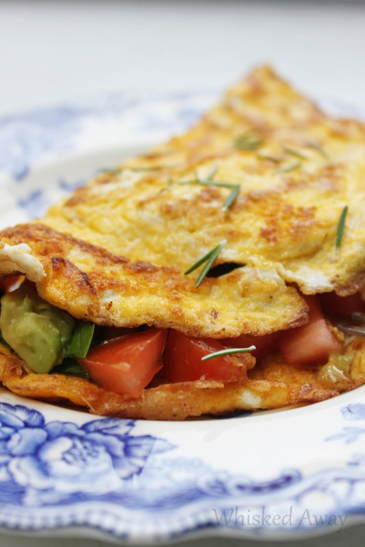 Feta, Tomato and Spinach Omelet + step by step instructions for making the perfect French Omelet